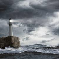 """Lighthouse-On-Cliff-In-Storm"" by johnlund"