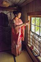 Japanese Woman with Empress Doll
