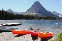 Kayaks at Lower Two Medicine Lake by Carol Groenen