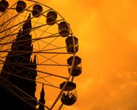 Fairground Wheel with Scott Monument Background in