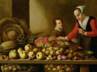 Girl selling grapes from a large table laden with
