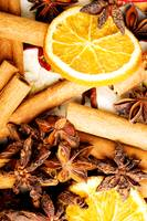 Cinnamon, orange and star anise close up photo.