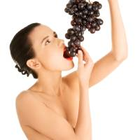 Beautiful sensual brunette eating grapes, isolated Art Prints & Posters by B-D-S Piotr-Marcinski