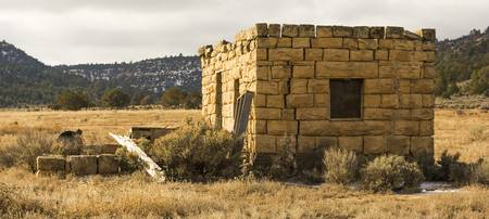 A Cracked Adobe Home on the Reservation