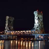 """Portage Lake Lift Bridge at night - Houghton,MI"" by rossetto"