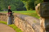 Curving Stone Wall and Woman