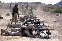 Marines fire their M240G medium machine guns and M