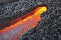 Lava flowing from small tunnel on flank of Pacaya
