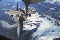 An F15C Eagle aircraft sits behind a KC135R Strato