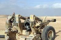 US Marines prepare to fire a howitzer near Baghdad