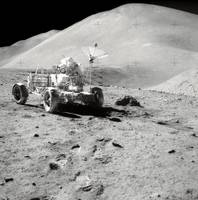 Astronaut works at the Lunar Roving Vehicle during