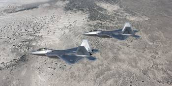 Two F-22 Raptors fly a training mission over New M