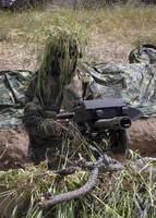 A soldier manning an MK19 automatic crew serve gre