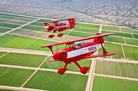 Two Pitts Special S-2A aerobatic biplanes in fligh