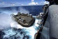 A landing craft air cushion enters the well deck o