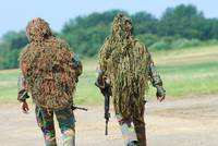Two snipers of the Belgian Army dressed in ghillie