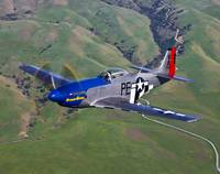 A P-51D Mustang in flight over Hollister, Californ