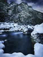 A river flowing through the snowy mountains of Rit