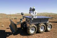 An astronaut drives an electric tractor on rugged