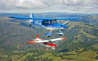 Two Champion Aircraft Citabrias in flight
