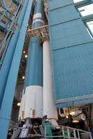 The second solid rocket motor is moved into place