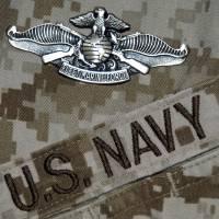 """The Fleet Marine Force Warfare Specialist Pin"" by stocktrekimages"