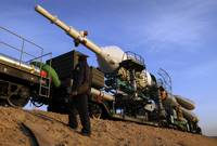 The Soyuz TMA13 spacecraft is transported by railc