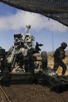 U.S. Marines fire an M777 howitzer
