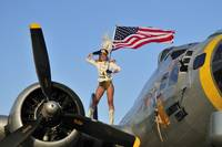 1940's style majorette pin-up girl on a B-17 bomb