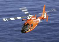 A Coast Guard HH 65A Dolphin rescue helicopter in