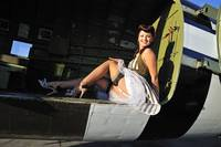 1940's style pin-up girl sitting inside of a C-47