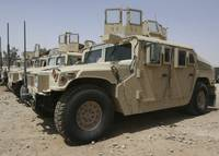 A row of humvees from Task Force Military Police