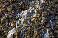 Brine falls from volcanic rock drop off to a runof