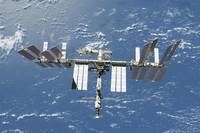 International Space Station backdropped by a blue