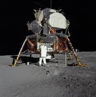 An Apollo 11 astronaut in front of the lunar modul