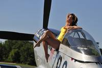 Retro pin-up girl sitting outside the cockpit of a