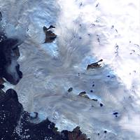 A small field of glaciers surrounds Baffin Bay alo