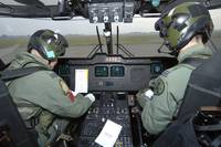 Pilots inside the cockpit of a Royal Air Force Mer