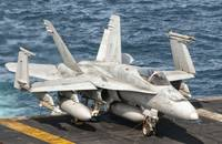 A US Navy F/A-18C Hornet tied on the flight deck o