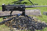 A .50 Caliber Browning Machine Gun with a pile of