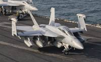 An F/A-18F Super Hornet moving to the catapult abo