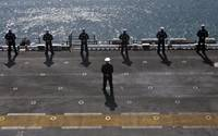 Sailors man the rails on the amphibious assault sh