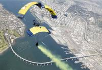 Members of the U.S. Navy parachute team above Nava