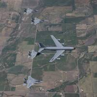 A KC-135R Stratotanker refuels four F-15 Eagles ov