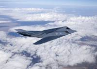 An F-117 Nighthawk stealth fighter in flight over
