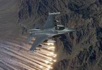 An F-16 Fighting Falcon releases flares during a t
