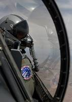 An F-16 pilot checks the position of his wingman d