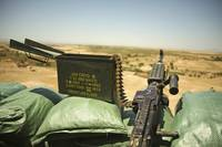 A M240B medium machine gun is positioned at an obs