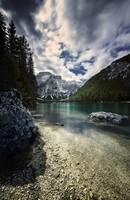 Lake Braies and Dolomite Alps against stormy cloud