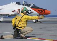 A shooter signlas the launch of a T-45A Goshawk tr